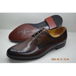 Brown dotted brogue shoe